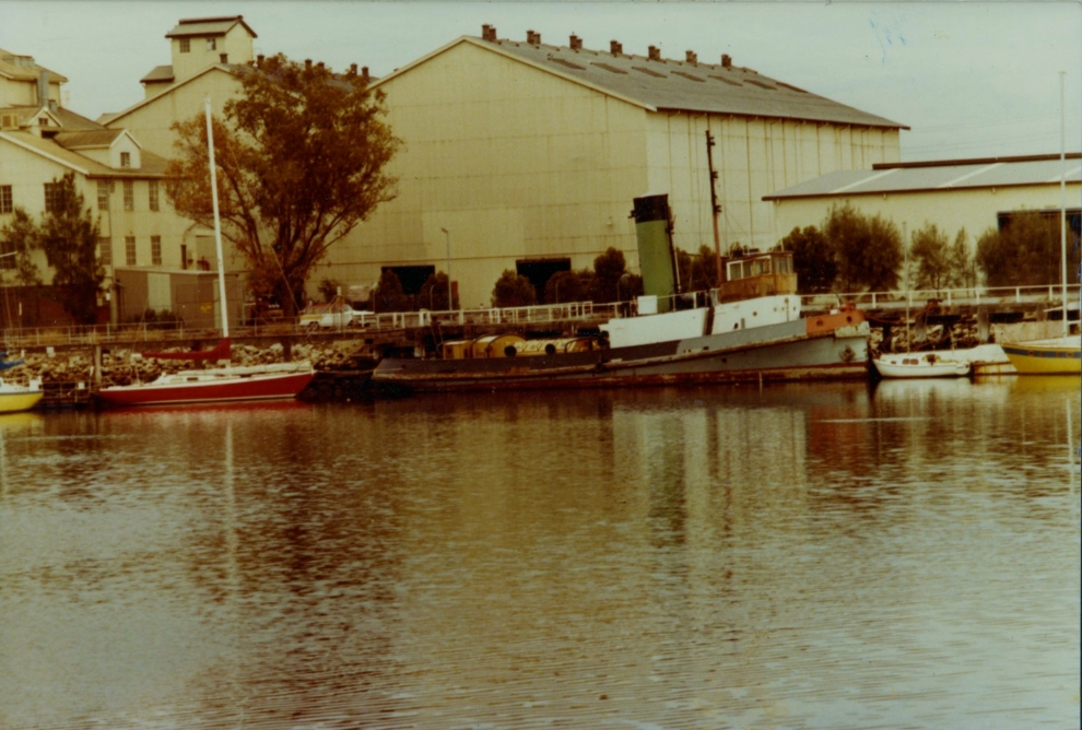 Yelta outside the CSR Refinery. The tug can be seen here painted many colours, occurring after its retirement. (Post 1977)