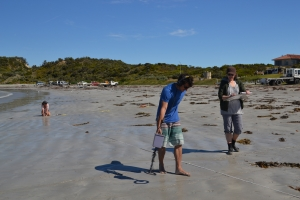 Figure 1. Myself (left) and fellow student Chelsea Colwell-Pasch (right) conducting a metal detector survey on shore during the 2013 Flinders University Maritime Archaeology field school.