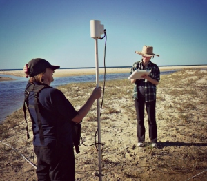 Peta Fray and Dana Gilmore conducting a magnetometer survey on Kirra Beach.