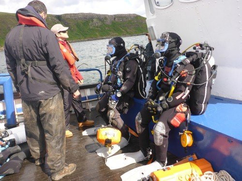 Figure 9. SAMPHIRE divers Drew Roberts (right) and John McCarthy (left) preparing to dive in Loch Bay on the second project site (Photo by Chelsea Colwell-Pasch).