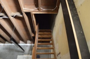 Stairway into dark loft in the Barracks.