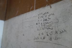 Writing on the wall of the right hand corner of the Barracks veranda