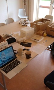 My workspace within the headquarters of the Museum of Western Zealand. Note that one cup of coffee was often insufficient for the magnitude of the task.